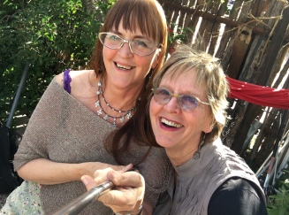Tess and Judy play with a selfie stick at @ Eye on the Mountain Gallery gig